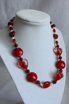 """~Love Affair Necklace~: Red Hot and steamy, you will look stunning with the """"Love Affair"""" necklace around your neck line. This piece key elements are made with, red glass beads of different shapes and textures, gold iris glass beads, and fresh water pearl beads.  By LeilaniJewelryDesign"""