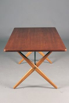 Hans J. Wegner; #303 Teak, Oak and Brass Dining Table for Andreas Tuck, 1950s.