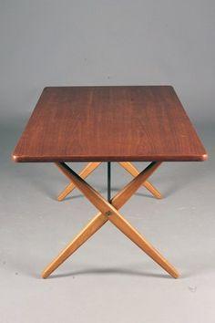 Hans J. Wegner; #303 Teak, Oak and Brass Dining Table for Andreas Tuck, 1950s.