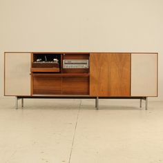 1960s George Nelson Thin Line Stereo Cabinet | USA    Stereo cabinet from the thinline series by George Nelson in rosewood. Two audio boxes on the outside. Inside ful catered Awai tuner and tapedeck and pick up.
