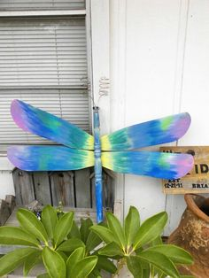 Dragonfly made from upcycled ceiling fan blades and a table leg