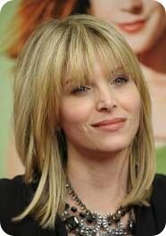 A great layered haircut is shown here on medium length hair. The layers are kept long and gradual on straight hair ad is paired with a fringe on top. This is another ideal haircut for heart shaped faces.