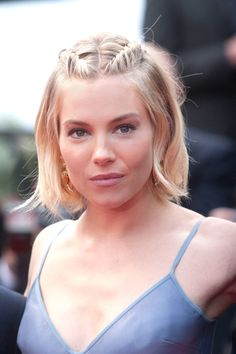 For Medium-Short Hair - Create a center part and use a 1.5 inch barrel to wave hair. Spritz with a salt spray and finger comb for a lived-in look. Create two french braids from front to the crown and pin to secure.