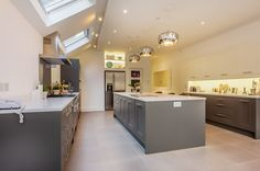 Kitchen Extension by www.hollandgreen.co.uk  Pale floor, roof lights, lots of space....
