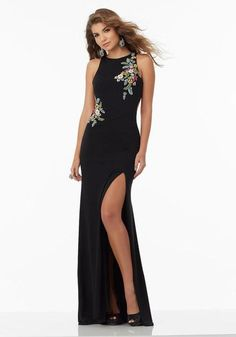 Form Fitting Jersey Prom Dress with High Scoop Neckline and Open Keyhole Back Bodice is Accented with Floral Beaded Appliqués Zipper Back Closure Colors Available: Black/Multi    Morilee Prom
