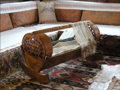 The cradle has always occupied a special spot in the home. It's the holder of some of our first dreams about the precious tiny human beings who've just House Of Savoy, Wooden Cradle, Islamic Architecture, Wood Bedroom, Cabinet Makers, Bosnia And Herzegovina, Simple Style, Around The Worlds, Couch