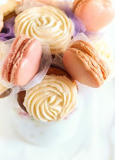 Macaron & Cupcake Bouquet by raspberri cupcakes. This has my friend Tracey from Wicked Good Cupcakes written all over it!