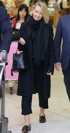The big cover up: Lara Bingle hid any signs of a reported pregnancy as she touched down in...