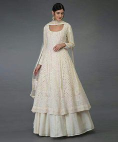 Be the center of focus in parties and occasions by wearing this Designer Lucknowi Anarkali Lehenga Suit. This Suit comes with Beautiful Chikankari work Anarkali style Kurti, Georgette self-print Lehenga and matching a dupatta with Chikankari work. This is a custom Anarkali suit and can be stitched to any sizing. Style Tip For an elegant look, pair this Anarkali Suit with statement earrings for an elegant look and carry a tote bag for a chic look. Details:  Lucknowi Anarkali Lehenga Suit…