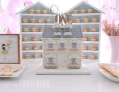 Our little doll is turning one! What better way to celebrate than to throw a dollhouse themed birthday party. Using an array of pastel colours, lots of balloons and having the most magical birthday cake ever, a dollhouse, this first birthday is what every little girls' dreams are made of!