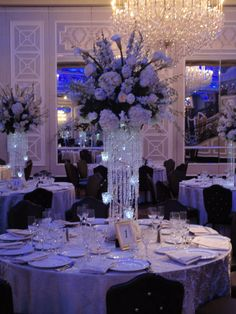 Hydrangeas, orchids and calla lilies in sparkling crystal stand