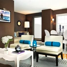 Dark Brown Walls with white Furnishings and trims