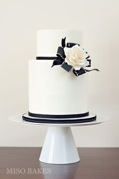 Double barrel buttercream cake with a sugarpaste rose brooch. Photo: Sylvia G Photography