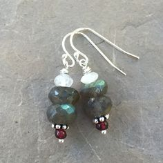 The facets really sparkle in these labradorite earrings! They have great blue flash and the garnet and moonstone really make the color pop!