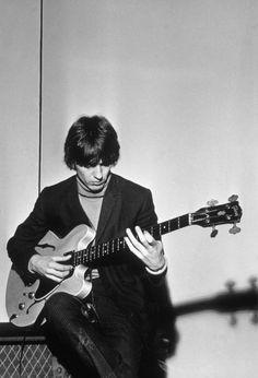 "George Harrison, De Montfort Hall, Leicester, England, 10 October 1964  Photo © Richard Mitchell/REX Shutterstock      ""[The Beatles would] sit around and play guitars, just playing music and fooling about. George was definitely more of the guitar aficionado."" - Mick Jones (a member of Sylvie Vartan's backing group in January 1964), Beatles Gear by Andy Babiuk"
