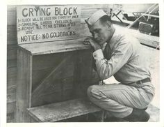 "1941- Soldier kneels at the ""Crying Block"", the modern version of the famed Wailing Wall, of the 350th School Squadron, U.S. Army Air Corps, at Eglin Field."