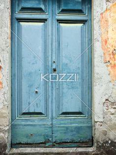 a wooden vintage door - A portrait of a closed blue wooden vintage door