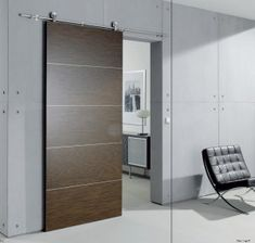 Love love love modern exposed sliding door hardware and the doors not too shabby either.not to mention the concrete walls. Modern Exterior Doors, Modern Sliding Doors, Sliding Closet Doors, Sliding Door Hardware, Modern Door, Modern Barn, Interior Barn Doors, Contemporary Barn, Door Hinges