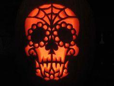 Raven's Dia de los muertos pumpkin carving
