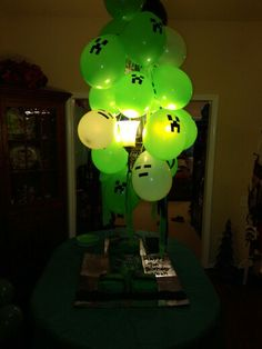 Put some Green Glow Sticks into Balloons and use a marker to make some Creeper…