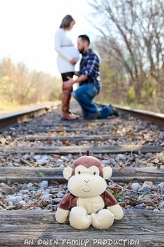 Mommy and Daddy on train tracks.