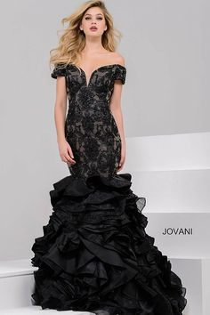 Gorgeous floor length form fitting black beaded lace mermaid evening gown with nude underlay features off the shoulder plunging neckline bodice and ruffled skirt.