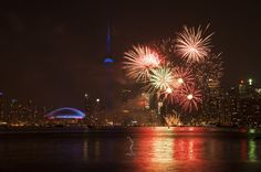 View of Toronto's beautiful skyline in the backdrop of Canada Day's fireworks