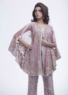 As we wave good bye to 2015 and step into the new year, luxury design house Ayesha Somaya is the first to unveil their latest luxury pret and formal wear range now available on order fo… Pakistani Cape Dresses, Pakistani Wedding Outfits, Pakistani Dress Design, Indian Dresses, Indian Outfits, Frock Fashion, Fashion Dresses, Party Kleidung, Couture Mode