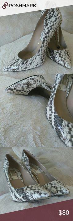 Michael Kors Snakeskin heels with silver trim Beautiful MK pointy toe pumps with silver lining tie and heel. These are classy and sexy! Very comfortable pumps almost new. Worn once!  No scuffs on snakeskin. Michael Kors Shoes Heels