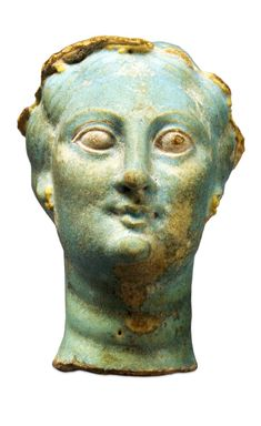 COMPASS Image Caption: Faience head of Arsinoe II  From Naukratis, Egypt, 3rd century BC