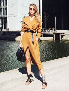 Pernille Teisbaek pairs a belted wrap dress with a statement pair of Miu Miu ballet flats