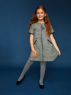 This navy grey tweed dress, by Fina Ejerique, is casual dressy perfection. The dress has an easy A-line silhouette with a front metal zipper closure. Black chenille trims at the sleeves, slanted front