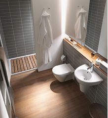 Teak slats on shower floor, opaque glass, wall mounted toilet and sink. This is just beautiful! Duravit.