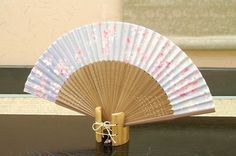 Authentic Japanese Hand Fan - Cherry Blossom (Sakura) #1! $20.00  The Japanese hand fans are an important symbol in Japan . They were used by warriors as a form of weapon, actors and dancers for performances, and children as a toy. In Japan fans are given to others as present and serve as trays for holding gifts. You would also find them sometimes used in religious ceremonies and events.