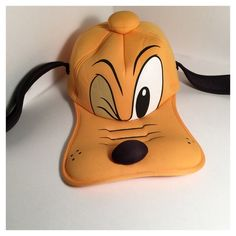 Pluto Baseball Cap Disney Parks Pluto Baseball Cap. This Baseball Hat was made exclusively for Disney theme parks.   Details from Disney: Sculptured foam Pluto hat Elastic strap for snug fit Fully lined One size fits most Polyester Imported Disney Accessories Hats
