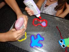 Time for Play: Colored Glue Sun Catchers - Dollar Tree glue to make it cheep but fun.