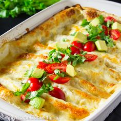 Today's recipe marks recipe number 200 on my blog! woohoo! Can't believe how quickly the recipes added up in only 2 years. We are celebrating the 200th recipe with these cheesy, gooey, melt in your mouth white sauce enchiladas. These enchiladas are loaded with chicken, corn, green chilies, cilantro, and lots of cheese. And of