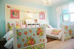 Girls Room - large photos above beds - rounded bunting - blue walls and florals