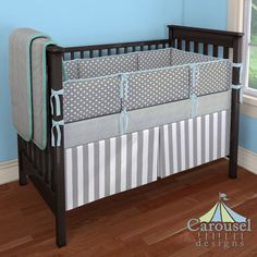 Crib bedding in Silver Dimpled Minky, Solid Teal, Gray Mini Swiss Cross, Solid Mist, White and Gray Stripe. Created using the Nursery Designer® by Carousel Designs where you mix and match from hundreds of fabrics to create your own unique baby bedding. #carouseldesigns