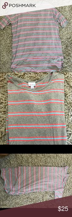 Lularoe new tunic Lularoe like new tunic-no tag attached BUT show no sign of wear! Great for all season! With cut offs, leggings? And layered under flannels! LuLaRoe Tops Tees - Short Sleeve