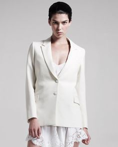 Two-Button Grain de Poudre Jacket by Givenchy at Last Call by Neiman Marcus.  Grain de poudre construction gives this Givenchy jacket a supremely subtle texture, to offset its sleek, sculptural lines.      Cream grain de poudre.     Notched lapels; two-button front.     Long sleeves with four-button cuffs.     Chest welt pocket; front flap pockets.     Side vents.     Wool.     Made in Italy.