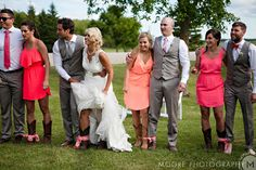 The Bride and Groom and their wedding party participated in a three legged race before dinner.