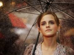 Emma Watson under the umbrella