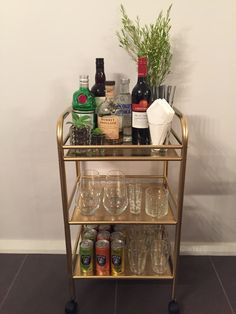 Bar cart finally done! Used a Draggan trolley from IKEA and sprayed it gold, I t… Bar cart finally done! Used a Draggan trolley from IKEA and sprayed it gold, I think it looks fab. Diy Bar Cart, Gold Bar Cart, Bar Cart Decor, Bar Carts, Ikea Bar Cart, Cafe Bar, Bandeja Bar, Bar Refrigerator, Home Bar Areas