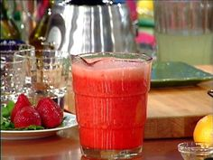 Cool and refreshing beverage with strawberries and lemons.