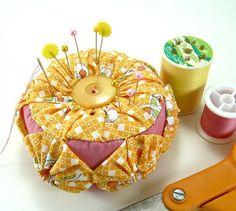 Yo-yo Pincushion http://www.craftypod.com/2010/03/16/how-to-make-a-yo-yo-pincushion/
