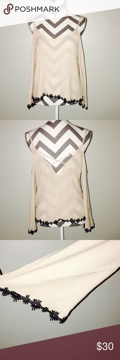 Bell Sleeve Boutique Brand Blouse Size Large Cream Boutique Brand Blouse with Bell Sleeves & Criss-Cross Back. Perfect Condition without flaws or signs of wear.   All items come from a smoke free home and are shipped on the same or following day an order is placed.   Reasonable offers are considered and often accepted. Deals on bundles are also available. Tops Blouses