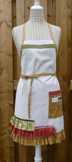 Perfect for all your creating and baking adventures! Canvas based full apron boasting a large pocket and ruffle. Extra long waist ties can be tied in the back or wrapped to the front and tied. Exposed seams have been stay-stitched to prevent excessive fraying. Completely machine washable and dryerable. Measures 28 inches long (including ruffle) and 25 inches wide. Size small (4 to 6)