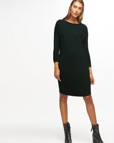 An easy to piece to wear with smart and casual designs, this dress is knitted from Italian merino wool. Designed for style and comfort, it has a relaxed for from neck to hem and chevron ribs to form a subtle textured pattern. A tubular neckline and hem are amongst some of the other key features. Wear with a tailored or leather jacket.