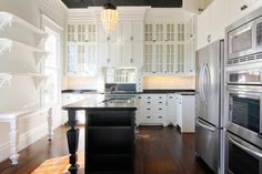 Keep it simple--even in a Victorian style kitchen.  Black.  White.  Stainless.  Hardwoods.  Will never go out of style.  Love the open shelves with intricate brackets.